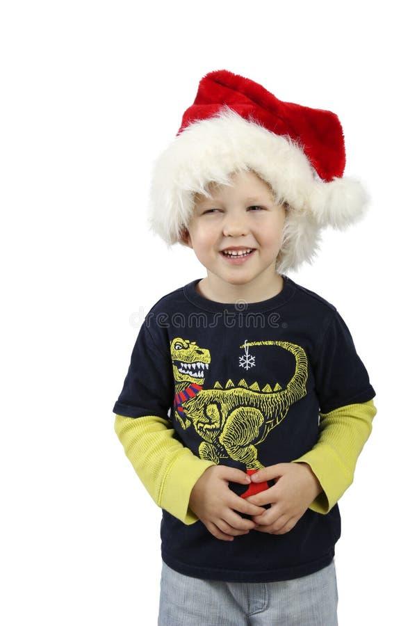 Le pysen som bär på den röda jultomtenhjälpredahatten royaltyfria foton