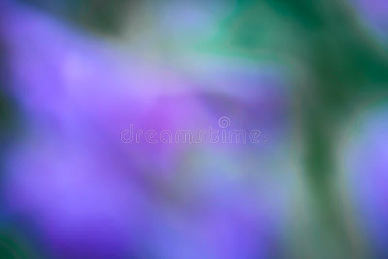Le résumé a brouillé le fond, le bleu, la violette et le vert colorés images stock
