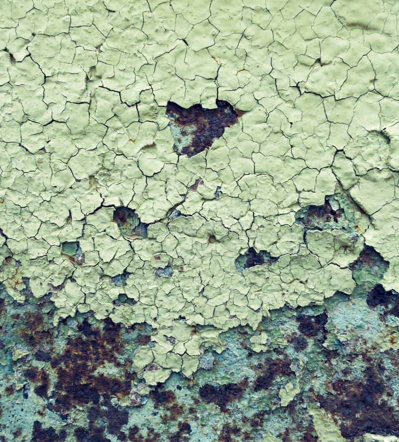 Le résumé a corrodé la peinture artistique rouillée d'épluchage de mur de papier peint de fer grunge coloré de fond photographie stock libre de droits