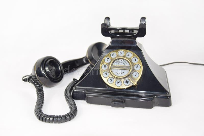 Le rétro téléphone, récepteur a repris et s'est étendu à côté du téléphone photo stock