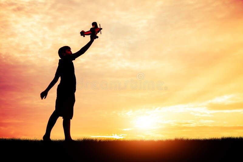 Le rêve d'un enfant qui veut voler partout silhouettent photo libre de droits