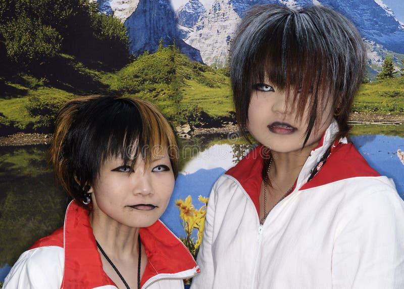Le ragazze giapponesi propongono in attrezzatura di Cosplay a Tokyo fotografia stock
