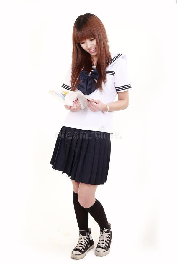 Le relevé japonais d'écolière photo stock