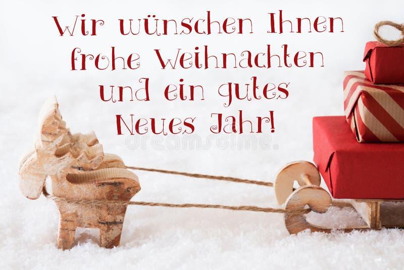 Le renne avec le traîneau, Frohes Neues Jahr signifie la bonne année image libre de droits