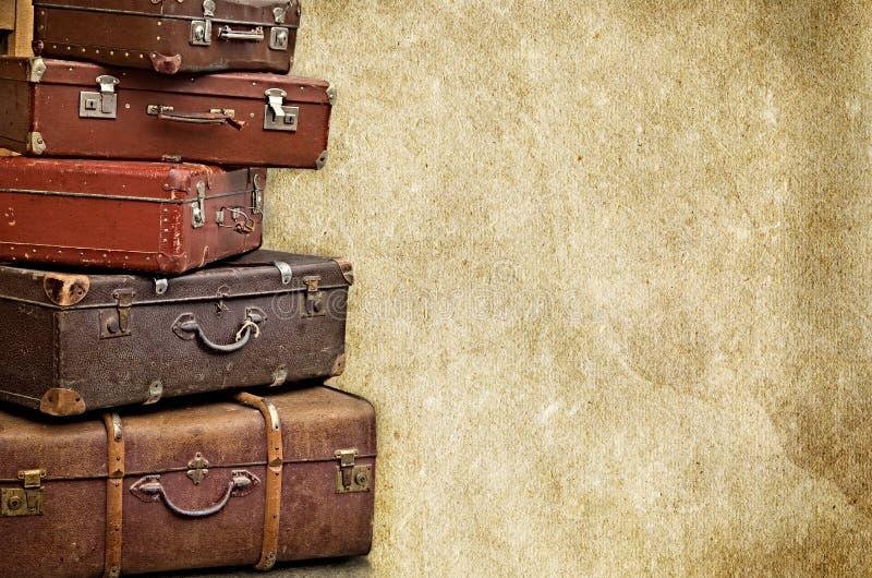 Le retro borse sulla vecchia annata hanno strutturato il fondo di carta immagini stock libere da diritti
