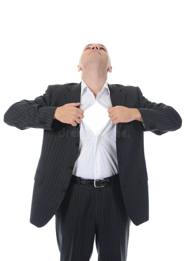 Le rotture dell'uomo d'affari aprono la sua camicia immagini stock libere da diritti