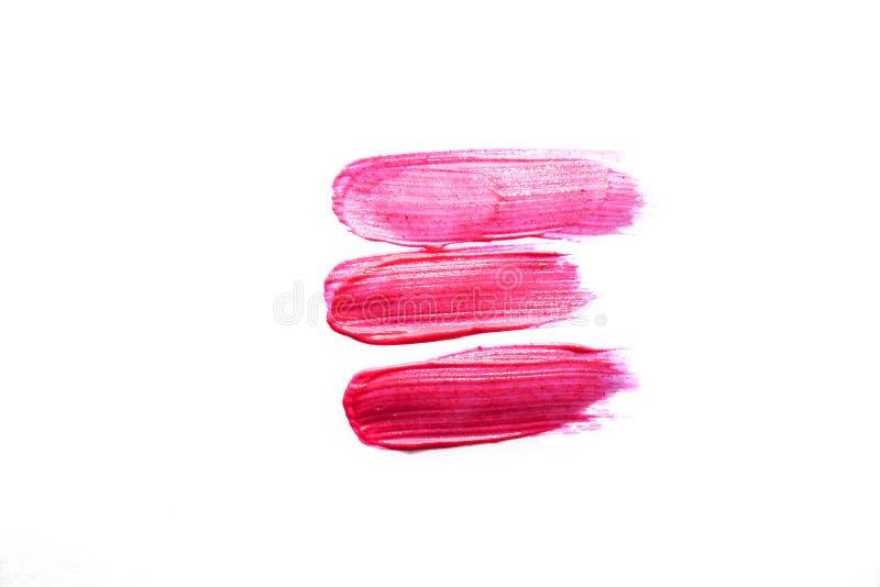 Le rouge à lèvres liquide rose taché, liquide rougissent d'isolement sur le fond blanc beaut? photographie stock libre de droits