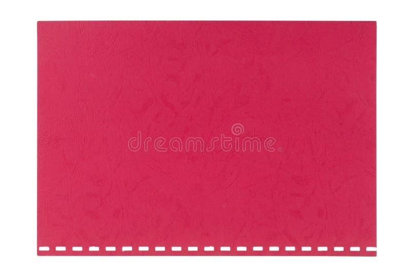Le rouge a gravé la feuille en refief de carton déchirée d'un carnet, d'isolement photographie stock libre de droits