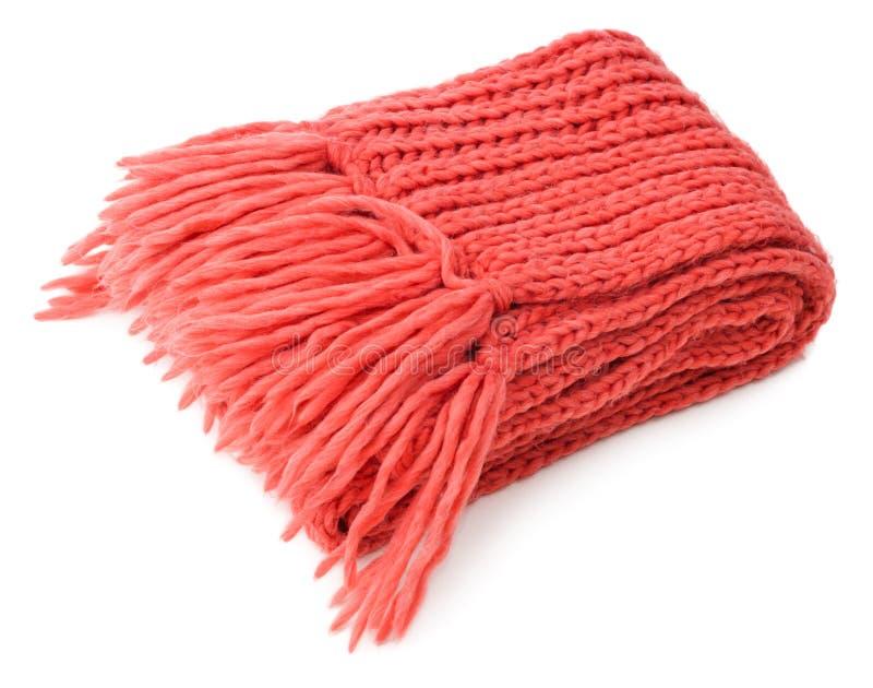 Le rouge a tricoté l'écharpe pliée images stock