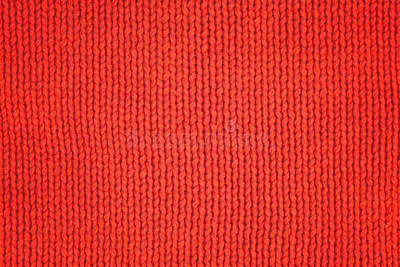 Le rouge a tricoté le tissu de laine comme texture Fond de textile photographie stock
