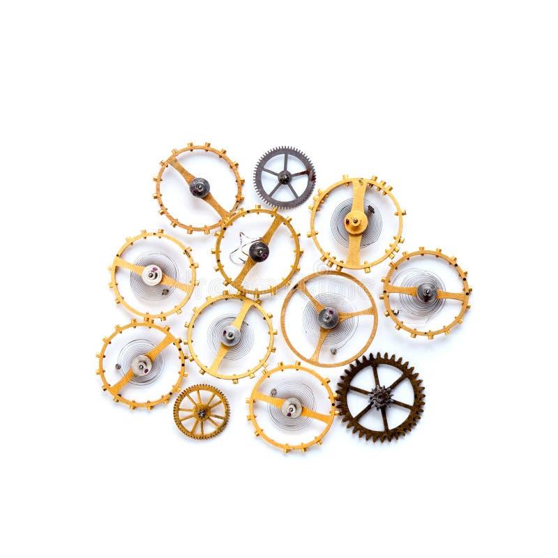 Le ruote dentate innesta l'ornamento del macchinario dello steampunk isolato su bianco La tecnologia d'annata parte il primo pian fotografie stock