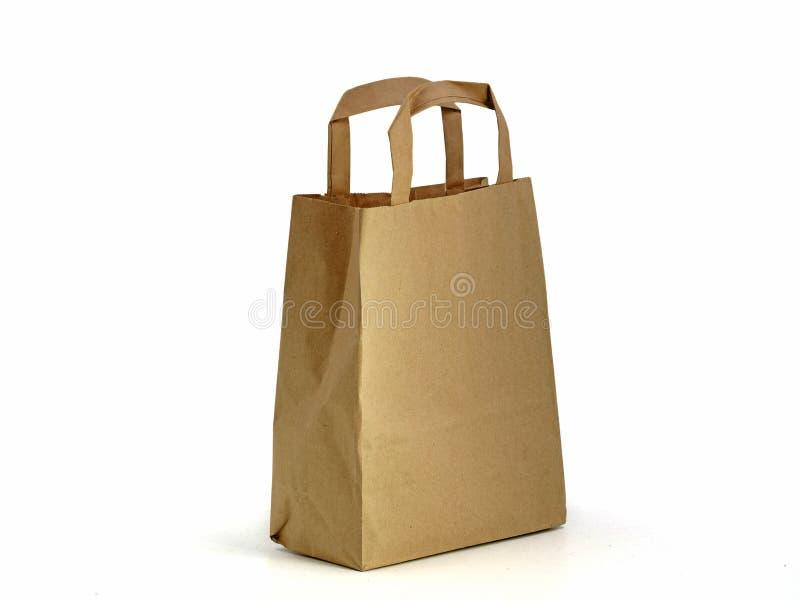 Le sac de papier de Brown d'isolement sur le fond blanc, évitent des sachets en plastique photographie stock libre de droits