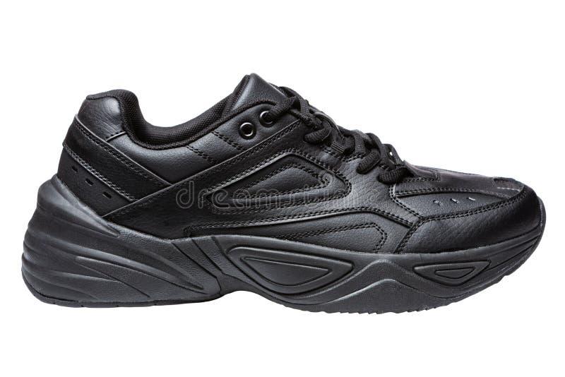 Le scarpe degli uomini neri di sport, scarpe da corsa per correre, su un fondo bianco immagini stock libere da diritti