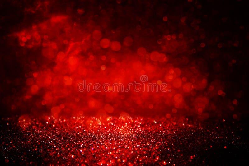 le scintillement noir et rouge allume le fond defocused photo stock
