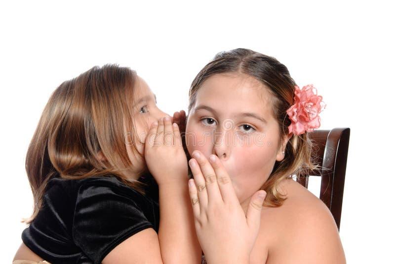 Le secret de la soeur photo stock