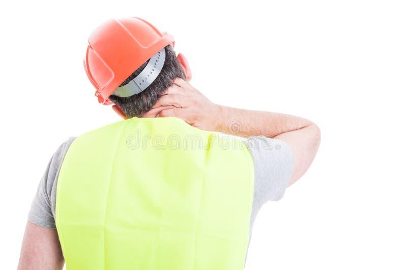 Le sentiment soumis à une contrainte de constructeur a fatigué et ayant la douleur cervicale photo stock