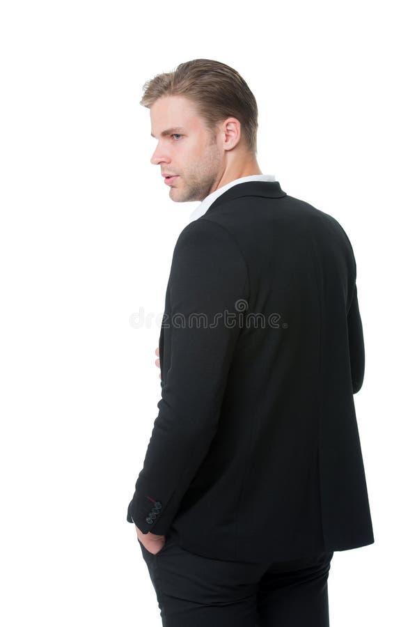 Le sien dénomment le classique L'homme bien toiletté dans la vue arrière d'équipement formel a isolé le blanc Moyens de code vest images libres de droits