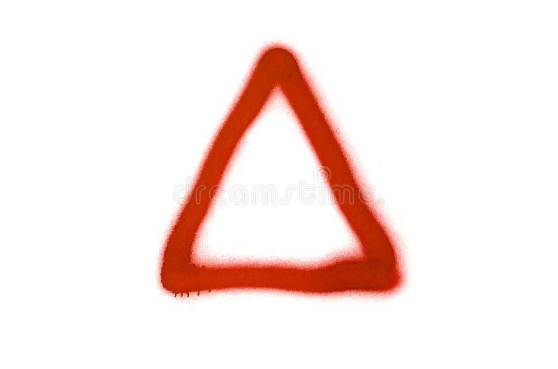 Le signe de triangle de graffiti a pulvérisé sur le fond blanc image stock