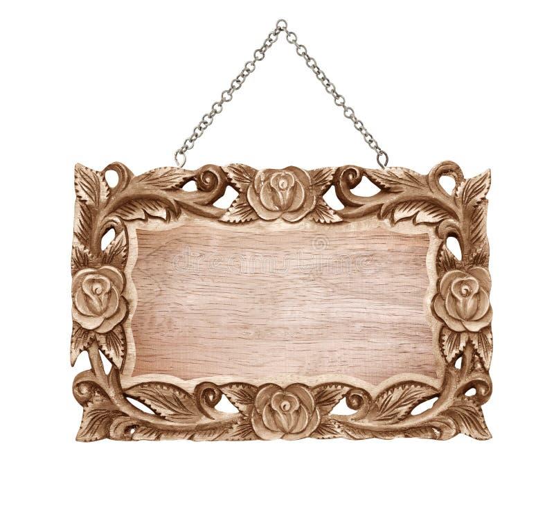 Le signe en bois a découpé le cadre avec la chaîne accrochant sur le blanc photo libre de droits