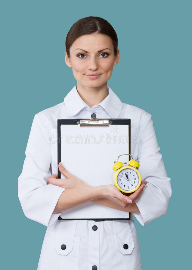 Le sjuksköterskan med en klocka royaltyfria foton
