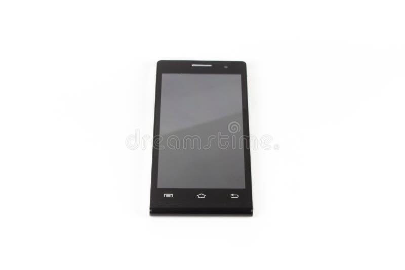 Le smartphone moderne noir avec l'écran vide se trouve sur la surface, h image stock