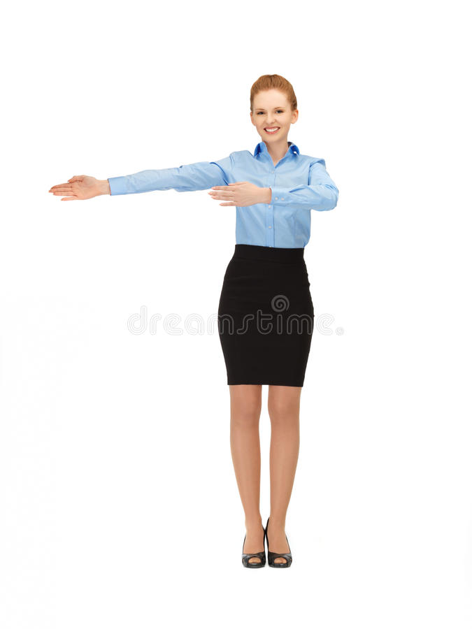 Le stewardessvisningriktning royaltyfri foto
