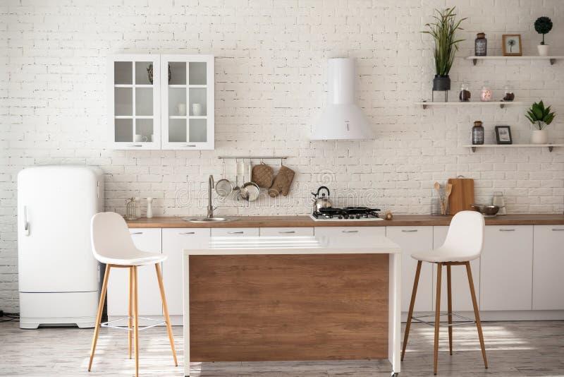 Le studio dans le style de la pièce blanche de cuisine est très confortable photo libre de droits