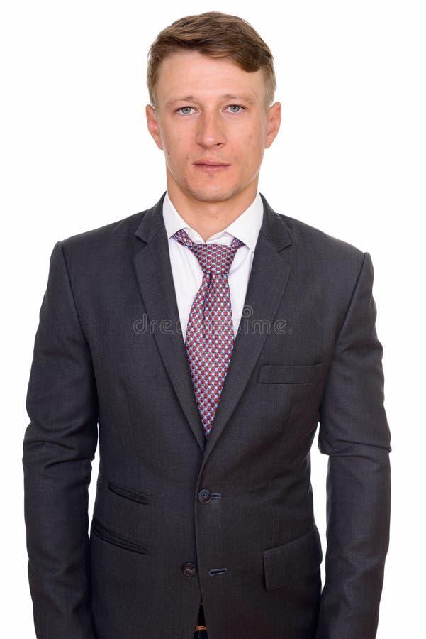 Le studio tir? du jeune homme d'affaires caucasien bel a isol? l'aga images stock