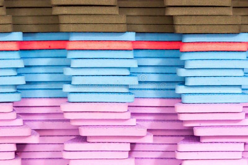 Le stuoie multicolori di puzzle di EVA Foam hanno impilato fotografia stock