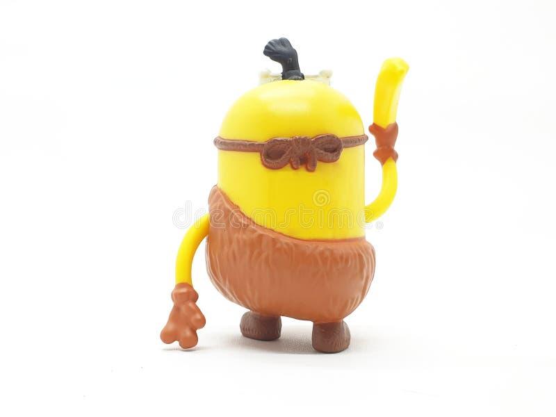 Le subordonné jaune de banane joue le modèle en plastique d'ignoble je film à l'arrière-plan d'isolement blanc images libres de droits