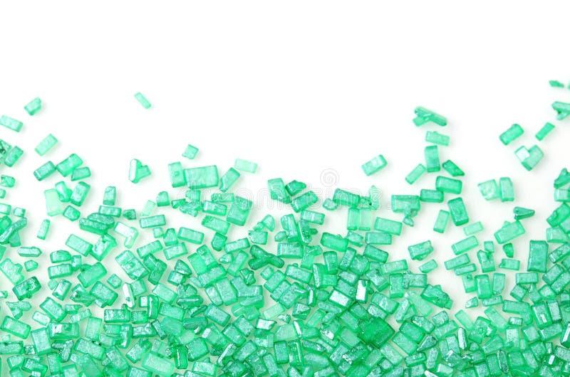Le sucre vert arrose sur le blanc photo stock