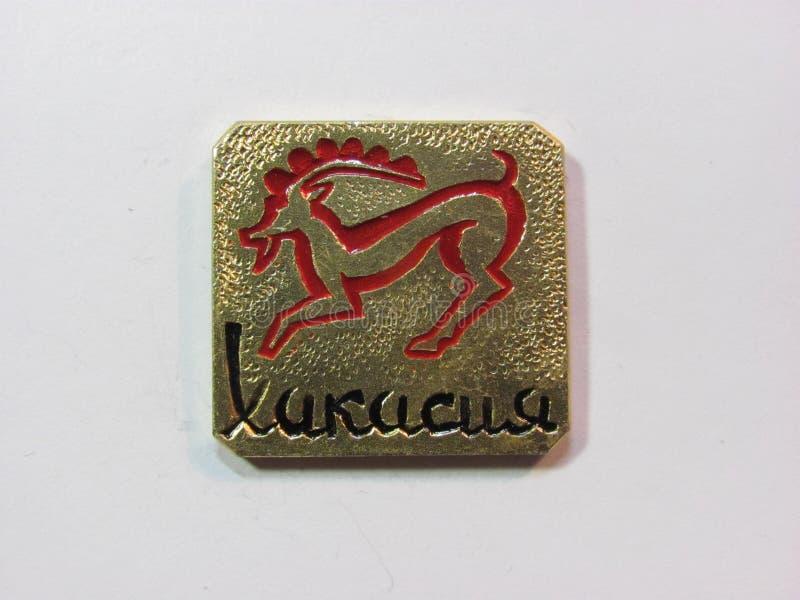 Le symbole de république de Khakasia badges le petroglif antic de la Russie photo stock