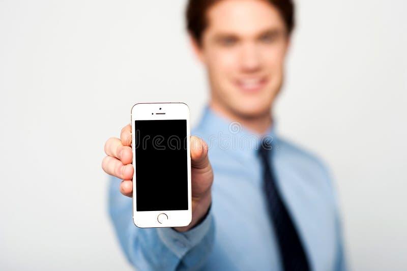 Le téléphone portable tout neuf est en vente, acheter maintenant ! photographie stock libre de droits