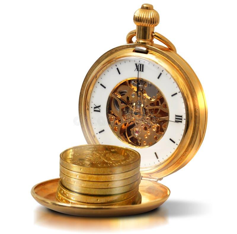 Le temps, c'est de l'argent - vieilles montre et pièce de monnaie d'or images stock