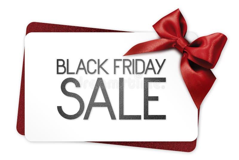 Le texte de vente de Black Friday écrivent sur la carte cadeaux blanche avec le ruban rouge images libres de droits
