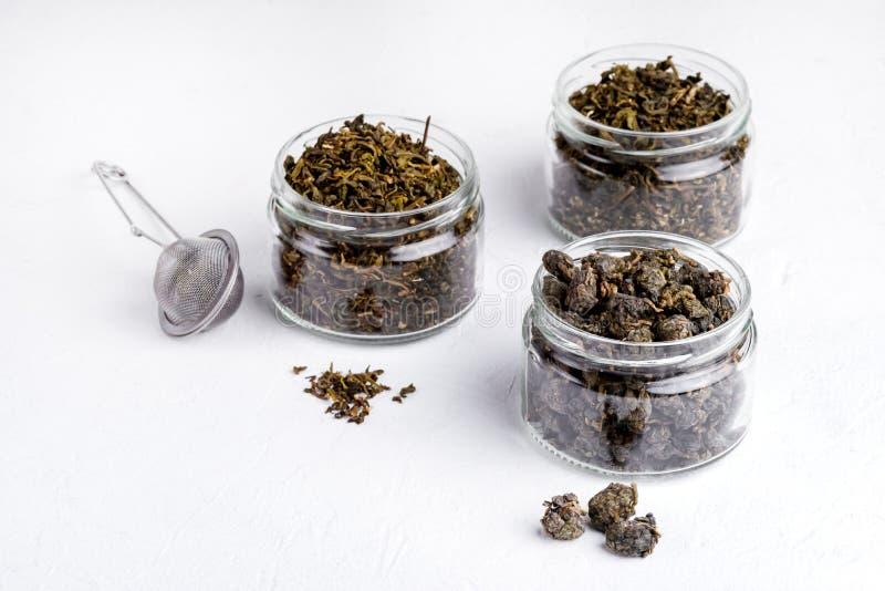 Le thé vert d'Oolong de boules de thé vert avec le thé vert de lotus avec la variété de gingembre de thé vert en verre cogne le t photographie stock libre de droits