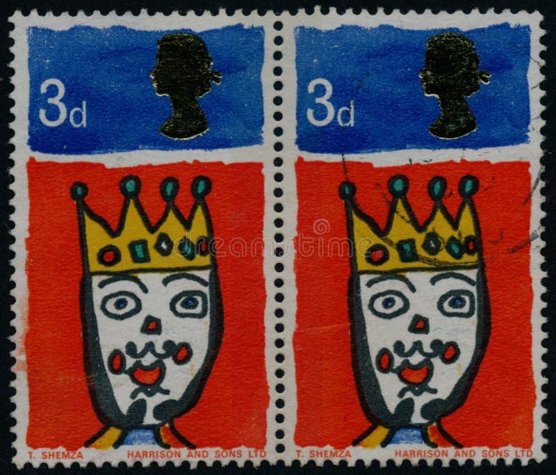 Le timbre de cru imprimé en Grande-Bretagne 1966, est consacré à Noël photographie stock libre de droits