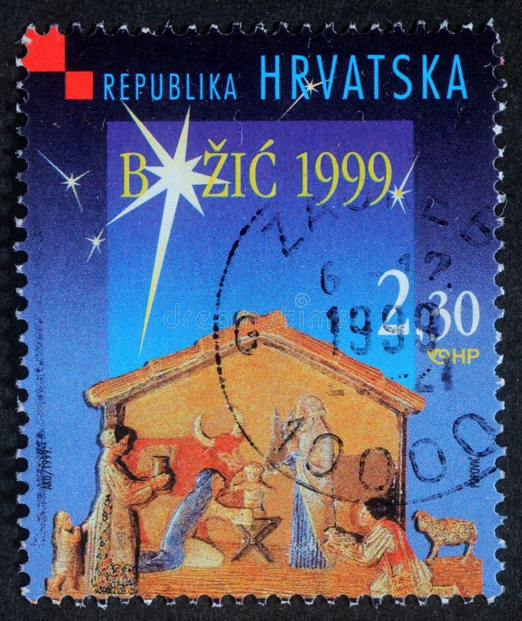 Le timbre de Noël imprimé en Croatie montre la garderie de Noël photo stock
