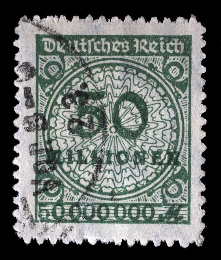 Le timbre imprimé en république Fédérale d'Allemagne montre l'image des nombres gonflés hyper images stock