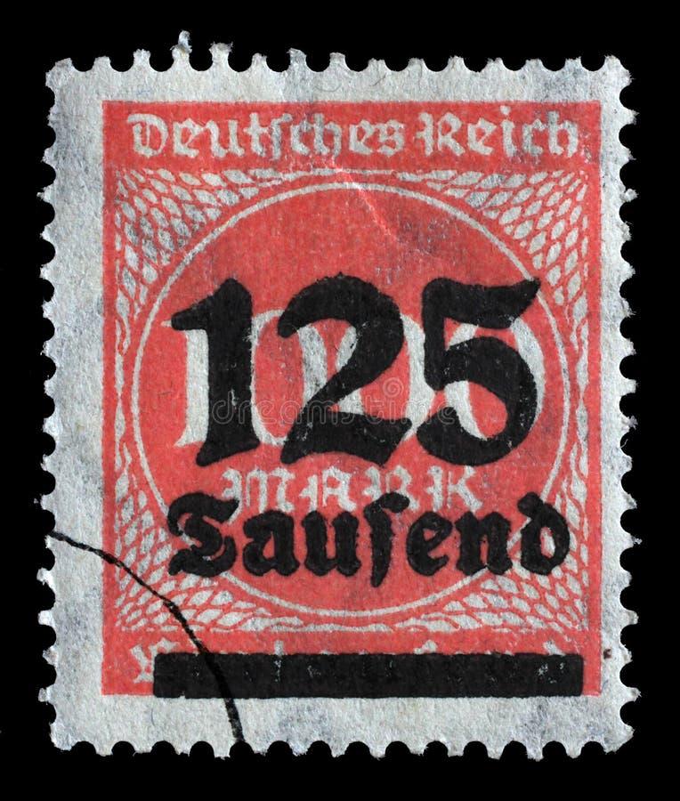Le timbre imprimé en république Fédérale d'Allemagne montre l'image des nombres gonflés hyper photo libre de droits