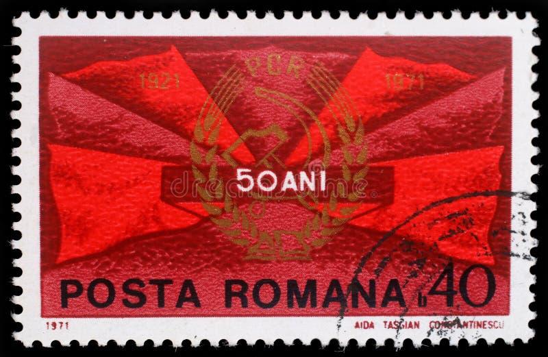 Le timbre imprimé en Roumanie montre les alertes et l'insigne de parti communiste photographie stock