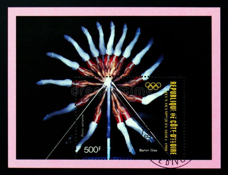 Le timbre-poste de la Côte d'Ivoire montre la barre horizontale, serie de Séoul de Jeux Olympiques d'été, vers 1988 photo stock