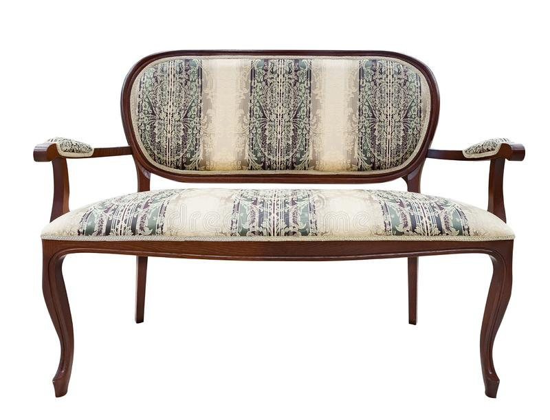 Le tissu beige tapissé par bois découpé par Canape classique de divan de sofa de fauteuil de style a isolé le fond blanc image stock