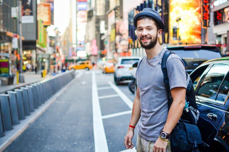 Le touriste urbain ajustent parfois New York, Etats-Unis photographie stock libre de droits