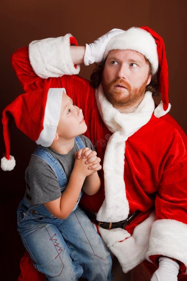 Le travail dur de Santa photographie stock