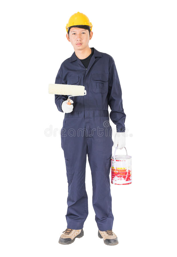 Le travailleur dans un uniforme utilisant un rouleau de peinture peint W invisible photos stock