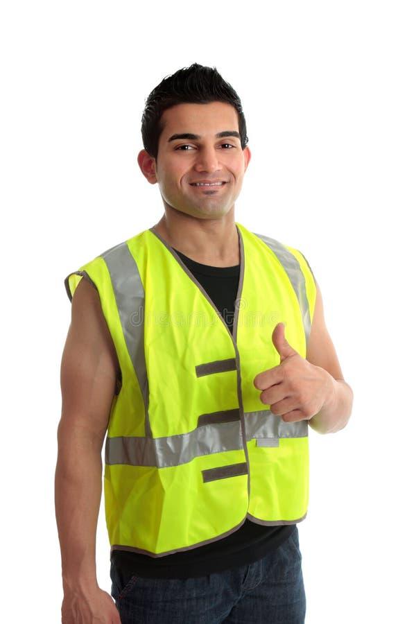 Le travailleur de la construction de constructeur manie maladroitement vers le haut photo libre de droits