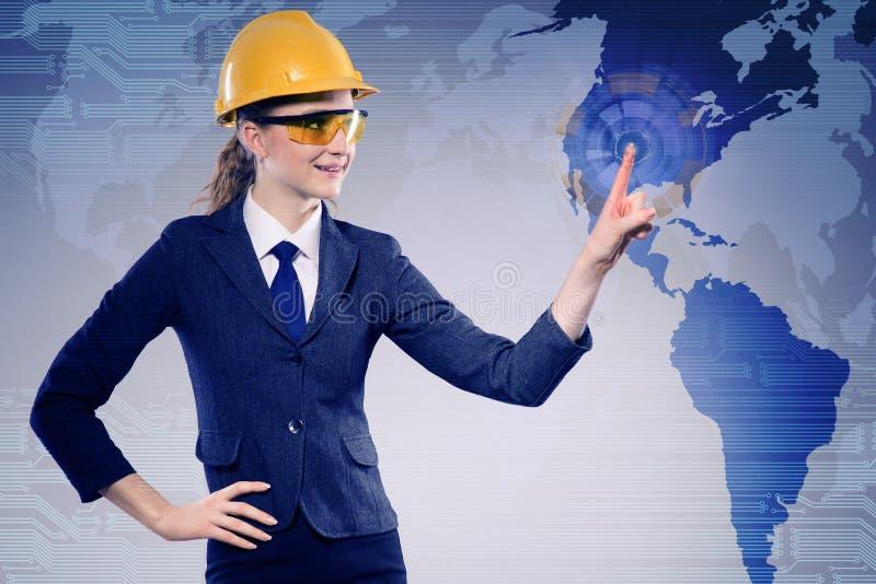 Le travailleur de la construction féminin dans le concept de mondialisation photo libre de droits