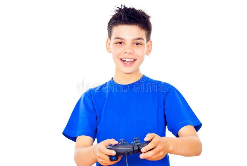Le type joue des jeux vidéo images stock
