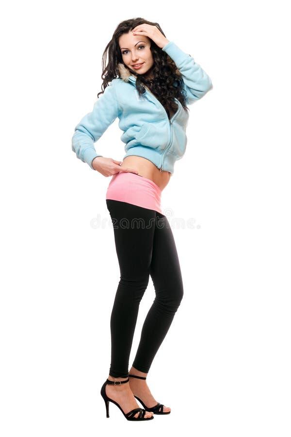Le ung brunett i svart damasker royaltyfri foto